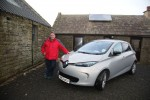 Steve Sankey with his Electric car pic orkney photographic